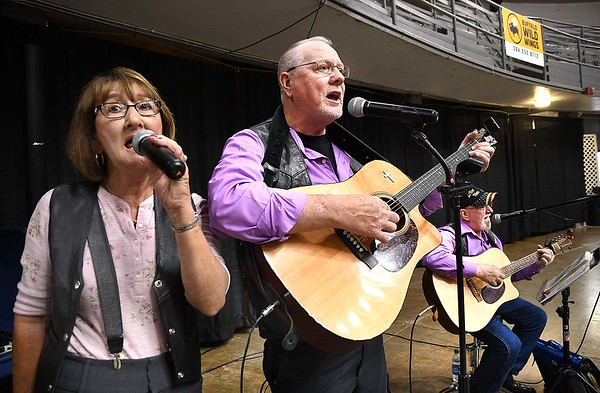 """Lou Honaker, left, Roger Cox and Lathan White, with """"For Him,"""" singing during, """"Senior Day Out"""" held at Beckley-Raleigh County Convention Center. The event had, music bingo, vendors, door prizes, information about products and services for our senior community and was co-sponsored by, The Register-Herald and Raleigh County Commission on Aging.<br /> (Rick Barbero/The Register-Herald)"""