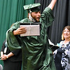 (Brad Davis/The Register-Herald) Graduating Wyoming East senior Clayton Hazelton reacts after collecting his diploma during school's 2019 Commencement Ceremony Friday night in New Richmond.