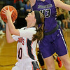 (Brad Davis/The Register-Herald) Summers County's Cheyenne Grahm drives to the basket as River View's Emily Auville defends Saturday night in Hinton.