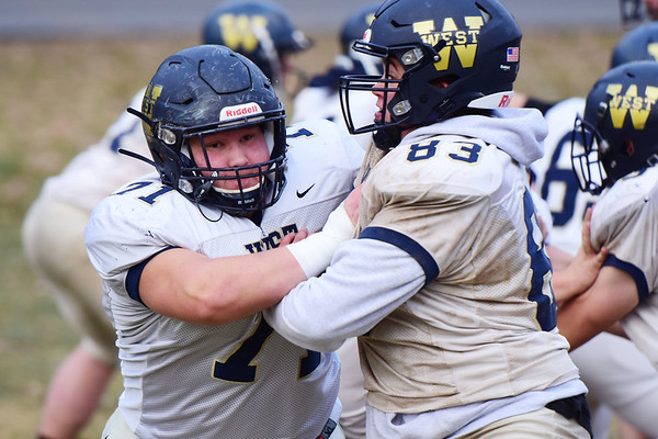 Greenbrier West's right tackle Hunter Starkey (71) works on his blocking with (83) during their football practice in Charmco on Tuesday. (Chris Jackson/The Register-Herald)
