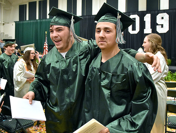 (Brad Davis/The Register-Herald) Graduating Wyoming East seniors exit the gym at the conclusion of the school's 2019 Commencement Ceremony Friday night in New Richmond.
