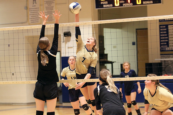 Greenbrier West's Kenley Posten (7) blocks an attempt by Greater Beckley Christian's Courtney Green (11) during the Class A Region 3 Section 2 volleyball tournament at Greenbrier West Tuesday. (Jenny Harnish/The Register-Herald)