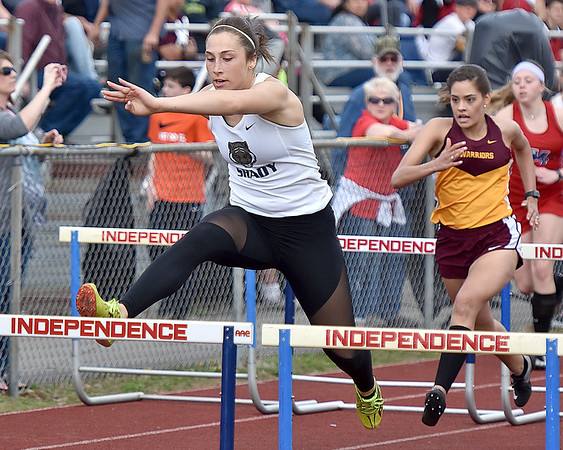 (Brad Davis/The Register-Herald) Shady Spring's Erica Hegele competes in the 110-meter high hurdles during the Dickey's Invitational Friday afternoon at Independence High School.