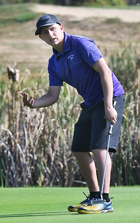 Aaron Addair, of Riverview, reacts to a putt he just missed on the par 4, 5th hole during the Class AA Region 3 championships held on Grandview Country Club.<br /> (Rick Barbero/The Register-Herald)
