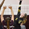 (Brad Davis/The Register-Herald) Greenbrier East's Madison Boswell leaps to spike the ball as George Washington's Julia McClanahan defends during the Class AA Region 3 championship tournament Saturday afternoon in Shady Spring.