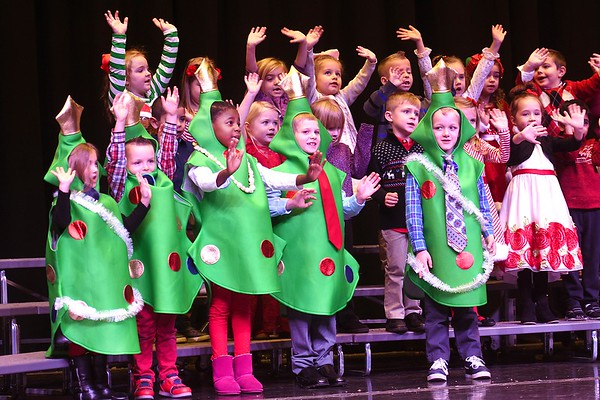Kindergarten class at Maxwell Hill Elementary School, sang Baby Christmas Tree and Jingle Bells during thier annual Christmas performance held at Woodrow Wilson auditorium Monday morning. Music teacher Vickie Pachuta directed each class from pre-k to 5th grade to sing two christmas song each along with sing alongs from the audience.<br /> (Rick Barbero/The Registewr-Herald)