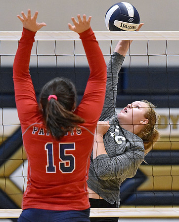 (Brad Davis/The Register-Herald) Westside's Lauren Thomas spikes the ball as Independence's Harleigh Hall tries to block during the Coalfield Conference Volleyball Tournament Saturday afternoon at Shady Spring High School.