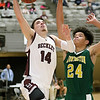 (Brad Davis/The Register-Herald) Woodrow Wilson's Bryce Radford drives and scores as Huntington's Chianti Littlejohn defends Wednesday night at the Beckley-Raleigh County Convention Center.