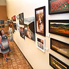 Cate Poage, left, and Linda King, both from Lewisburg, look over The Register-Herald Southern WV Professional Photographers Exhibit that's currently hanging 34 images presented by, Steve Brightwell, Andrea Martin, Ed Rehbein, Rick Barbero, Jenny Harnish, Tim Tilley, Perry Bennett and Tom Hindman.<br /> (Rick Barbero/The Register-Herald)