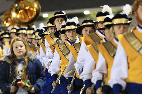 The Greenbrier West marching band comes out on the field ahead of Friday night's game against Midland Trail at Greenbrier West High School. (Jenny Harnish/The Register-Herald)