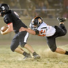 (Brad Davis/The Register-Herald) Summers County defender Dylan Hardy catches Liberty quarterback Issac Atkins in the backfield for a sack Friday night in Glen Daniel.