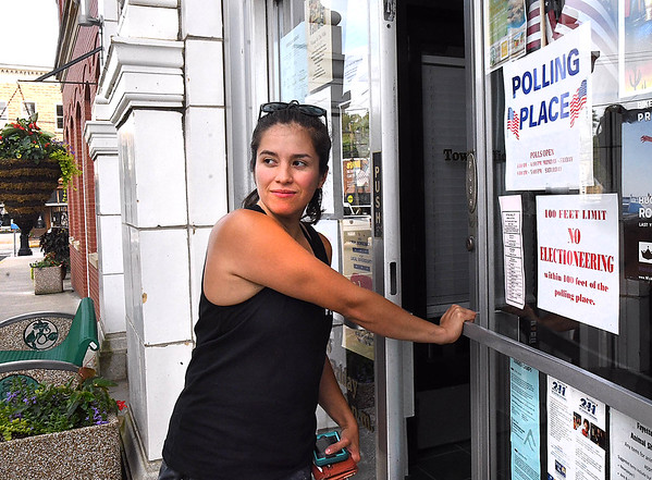 Jenny Martos entering City Hall Tuesday evening on Court Street to cast her vote for the municipal election.<br /> (Rick Barbero/The Register-Herald)