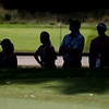 Fans take cover in the shade during the first round of golf of A Military Tribute at The Greenbrier in White Sulphur Springs on Thursday. (Chris Jackson/The Register-Herald)