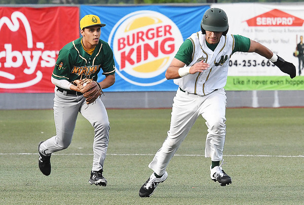 Michael Pineiro, of WV Miner, right, gets caught in a run down against, Christian McKelvey, of Normal CornBelters, Tuesday evening at Linda K. Epling Stadium in Beckley.<br /> (Rick Barbero/The Register-Herald)