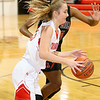 (Brad Davis/The Register-Herald) Greater Beckley Christian's Allie Smith drives to the basket as Oak Hill's Marcayla King defends Friday night in Prosperity.