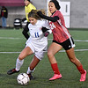 (Brad Davis/The Register-Herald) Morgantown's Samantha Brown, left, holds off Hurricane's Amiyah Donaldson to maintain possession Friday evening at the YMCA Paul Cline Memorial Sports Complex.