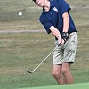 Todd Duncan, of Shady Spring, chips up on the par 4 8th hole during the Class AA Region 3 championships held on Grandview Country Club.<br /> (Rick Barbero/The Register-Herald)
