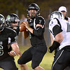 (Brad Davis/The Register-Herald) Wyoming East quarterback Seth Ross steps up in the pocket against Westside Isaac Mosley Friday night in New Richmond.