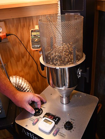 Jason Young, owner, of White Oak Bee Company, roasting coffee at his home-based local coffee roaster business. <br /> (Rick Barbero/The Register-Herald)