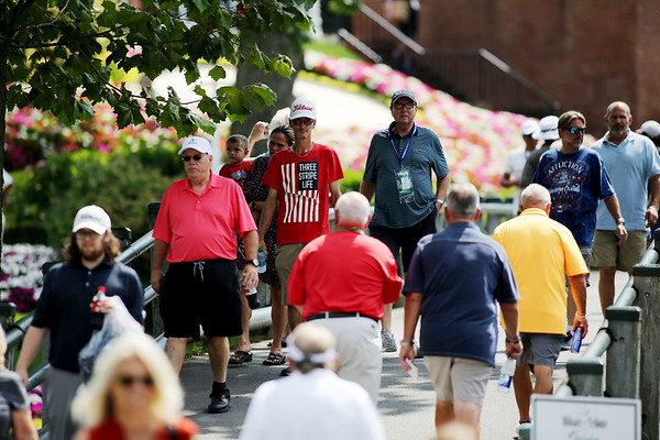 Fans make they way across the bridge by the No. 1 hole during the first round of golf of A Military Tribute at The Greenbrier in White Sulphur Springs on Thursday. (Chris Jackson/The Register-Herald)