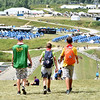(Brad Davis/The Register-Herald) A trio of scouts make their way back to their base camp during the last day of World Scout Jamboree activities Thursday afternoon at the Summit Bechtel Reserve. By the end of today, almost all of the scouts will be on their way back their respective home countries, and the vast fields of base camps and tents will be taken down.