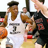 (Brad Davis/The Register-Herald) Greater Beckley Christian's Orlando Potter drives to the basket as Trinity's Logo Zervos defends Saturday afternoon in Prosperity.