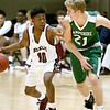 (Brad Davis/The Register-Herald) Woodrow Wilson's B.J. Mitchell holds off Hampshire's Drew Keckley as he's pressured at mid court during Big Atlantic Classic action Friday night at the Beckley-Raleigh County Convention Center.