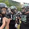(Brad Davis/The Register-Herald) Wyoming East players congregate during warm-ups Friday night in New Richmond.