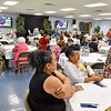 (Brad Davis/The Register-Herald) Friends, family, current, former and prospective workers and volunteers sit to watch a video prior to dinner as they come together for the Beckley Dream Center's 25th anniversary celebration Sunday afternoon at their food pantry and headquarters behind the Family Worship Center.