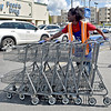 (Brad Davis/The Register-Herald) Kroger employee Neal Stringer hauls buggies back to the store at the Harper Road location Sunday afternoon.