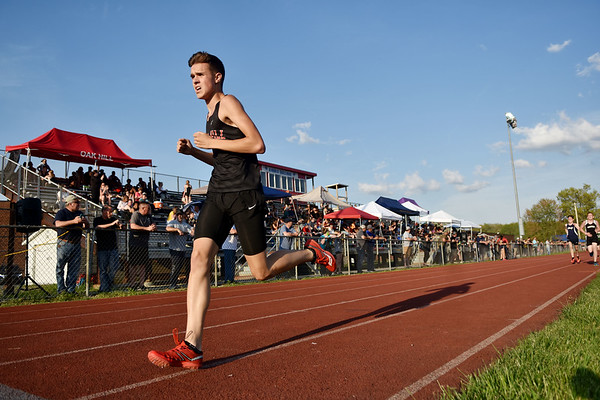 Oak Hill's Mason Harp runs to victory during the boys 1600 at the Coalfields Conference track meet in Coal City on Tuesday. (Chris Jackson/The Register-Herald)