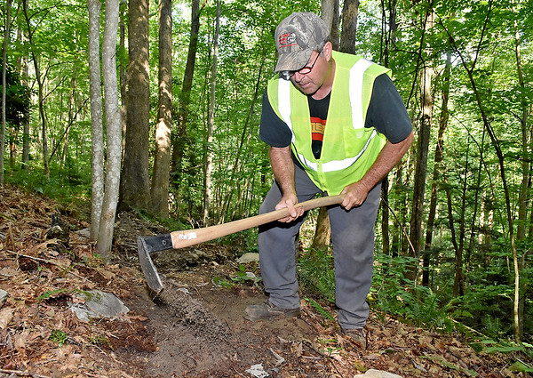 (Brad Davis/The Register-Herald) Gary Morefield, recently appointed as the City of Beckley's Trails Specialist, works on the trails around the YMCA Paul Cline Memorial Sports Complex Wednesday afternoon.