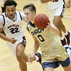 (Brad Davis/The Register-Herald) Shady Spring's Tommy Williams hustles up the court as Woodrow Wilson's Richard Law defends Saturday night at the Little General Battle for the Armory.