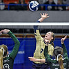 (Brad Davis/The Register-Herald) Greenbrier West's Kenley Posten leaps to spike the ball as Paden City's Brandis Dalrymple, left, and Hallie McDonald defend during State Volleyball Tournament action Friday afternoon at the Charleston Civic Center.