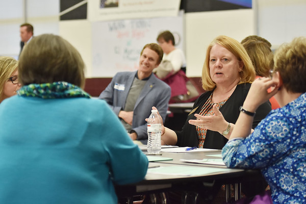 Sonya White, with the West Virginia Department of Education, speaks to her table during a gathering by the West Virginia Department of Education with stakeholders on education at Woodrow Wilson High School in Beckley on Thursday.