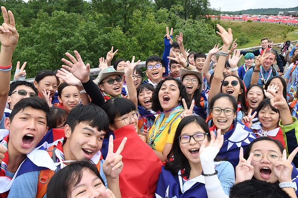 Scouts, from Taiwan, waving to other scouts on top of the Consul Energy Bridge during the World Scout Jamboree at the Summit Bechtel Reserve in Glen Jean.