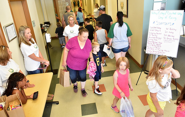 (Brad Davis/The Register-Herald) Scenes from Valley College's Day of Caring Saturday.
