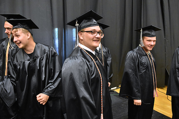 (Brad Davis/The Register-Herald) Graduating Westside seniors line up behind the stage before being called to collects their diplomas during the school's Commencement Ceremony Saturday afternoon in Clear Fork.