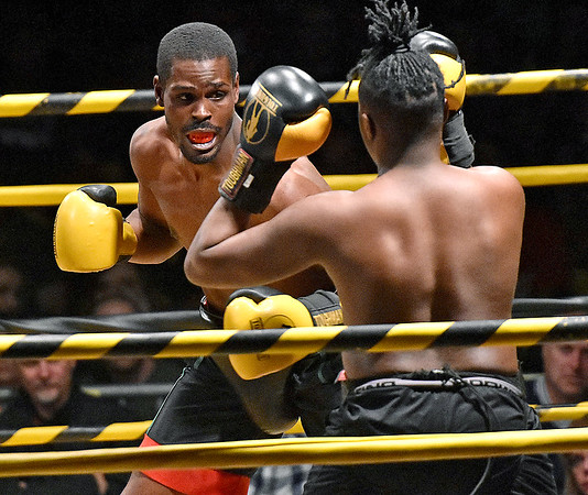 (Brad Davis/The Register-Herald) Beckley's Eric Coleman, left, takes on Clarence Pressley in a heavyweight matchup during the Original Toughman Contest Friday night at the Beckley-Raleigh County Convention Center. Pressley would win the fight.