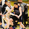 Greenbrier West's Brooklyn Morgan (22) and Midland Trail's Taylor Harrell (45) go for a loose ball during their basketball game in Charmco on Thursday. (Chris Jackson/The Register-Herald)