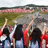 Women scouts from Chile, on the Consul Energy Bridge, waving at other scouts during the World Scout Jamboree at the Summit Bechtel Reserve in Glen Jean.