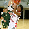 (Brad Davis/The Register-Herald) Greater Beckley Christian's Elijah Edwards drives to the basket as Notre Dame's Clay Martino defends Saturday night at the Little General Battle for the Armory.