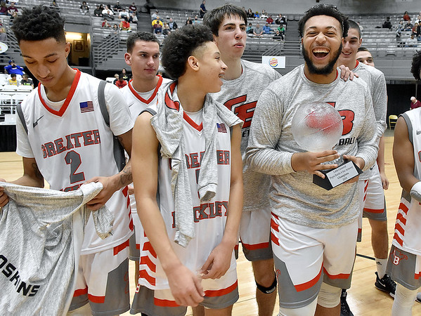 (Brad Davis/The Register-Herald) Greater Beckley Christian players collect the trophy after defeating Notre Dame in the Pepsi Division Championship game Saturday night at the Little General Battle for the Armory.