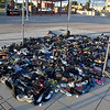 (Brad Davis/The Register-Herald) A display of 397 pairs of shoes completely fill the outline of the state of West Virginia atop Beckley's Intermodal Gateway, the number of people lost to suicide in 2017 during the opening moments of the Walk to Fight Suicide Saturday evening. Those numbers, expected to rise when the statistics for the 2018 and 2019 calendar years are finalized, rank West Virginia around 7th in the nation.