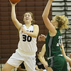 (Brad Davis/The Register-Herald) Woodrow Wilson's Laken Ball drives and scores as Wyoming East's Emily Saunders defends Saturday night in Beckley.