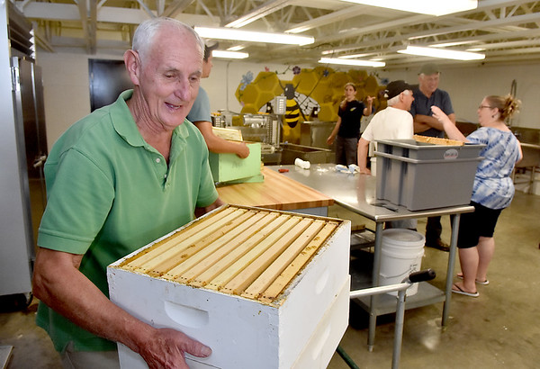 (Brad Davis/The Register-Herald) Steve McCoy, a home beekeeper from Hilldale, during an open house and demo event at Shady Spring High School's new honey extraction facility August 3.