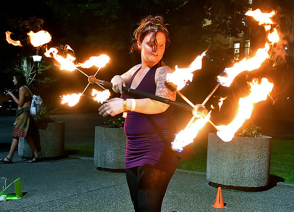 (Brad Davis/The Register-Herald) Local artist, performer and fearless master of flames Tori Lilly lights up the night as she executes moves during an after-hours fire dancing performace and demo in Beckley's Underground Saturday night, part of BEX activities in and around the city. The inaugural arts and entertainment festival wrapped up a successful week full of groundbreaking events Sunday.