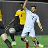 (Brad Davis/The Register-Herald) WVU Tech's Manuel Garcia battles for possession in front of the net as University of Maine at Fort Kent's Aaron Boateng defends Wednesday night at the YMCA Paul Cline Memorial Soccer Complex.