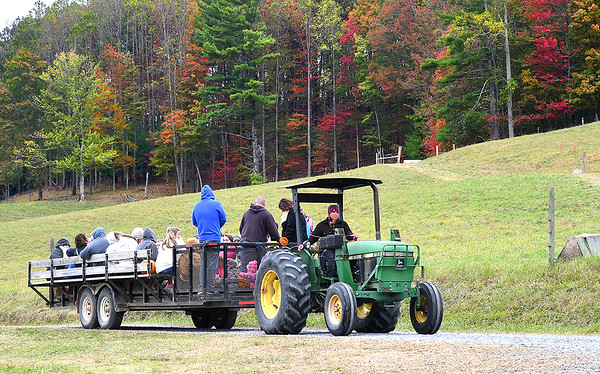 Tractor ride at the Okes Family Farm in Cool Ridge.<br /> (Rick Barbero/The Register-Herald)