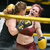 (Brad Davis/The Register-Herald) Scarlett Whitley, right, takes on Candie Benedict in a women's lightweight class matchup during the Original Toughman Contest Friday night at the Beckley-Raleigh County Convention Center. Whitley would win the fight.
